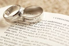 Bible and rings. Two rings on open Bible - 1. Corinthians chapter 13 Royalty Free Stock Image