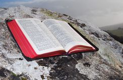 Bible on a rock Royalty Free Stock Images