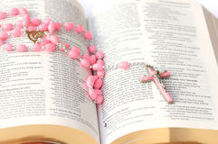 Bible and rosary Stock Images