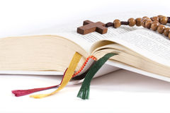 Bible with rosary Stock Images