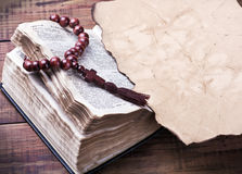 Bible with rosary Stock Photos