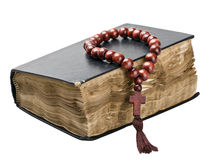 Bible and rosary. Isolated on white background Royalty Free Stock Photo