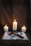 Bible, Rosary, Crucifix and Three Candles Royalty Free Stock Image
