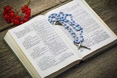 Bible with rosary Royalty Free Stock Image