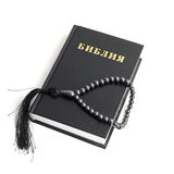Bible with rosary, white background Stock Photography