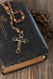 Bible with rosary Stock Photography