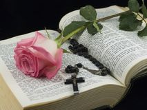 Bible with rose and crucifix Stock Photos