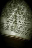 Bible Series Revelation sepia. Bible Series. close up detail of antique holy bible open to the gospel according to the revelation of st. john the divine in the Stock Images