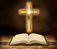 Bible and shining crucifix Royalty Free Stock Photos