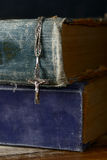 Bible and silver cross Stock Photography