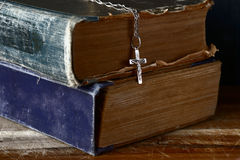 Bible and silver cross Royalty Free Stock Photos
