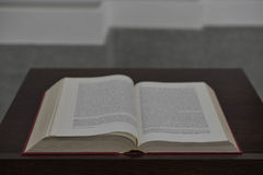 The Bible. Bible sitting on a wooden  pulpit. Switzerland Stock Photography
