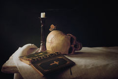 Bible, Skull, Candle as Symbol for Life, Death and Resurrection. Vanitas; Bible, Skull, Candle as Symbol for Life, Death and Resurrection Royalty Free Stock Images