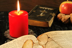 Bible, songbook and candle. Christmas decoration with old songbook, red candle and old bible stock photo