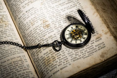 Bible and steampunk clock Royalty Free Stock Image