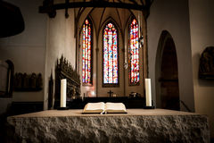 Bible in stone altar Royalty Free Stock Image