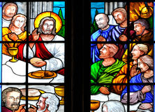 Bible story on stained glass window of church. Stained glass window of Catholic church, about the Jesus story from Bible Stock Image