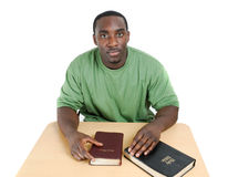 Bible studies student with bibles. This is an image of student preparing for with two bible studies stock photo