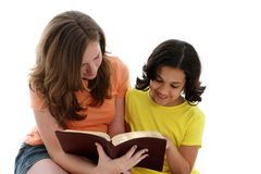 Bible Study. Girls having a bible study on white background Stock Image