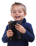 Bible study. Little boy holding the bible and smiling isolated on white Royalty Free Stock Photography
