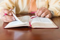 Bible study by a man of God or Pastor Stock Images