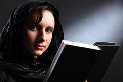 Bible study for religious young woman in headscarf Stock Photography