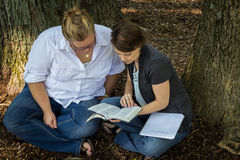 Bible sutdy up close. Two ladies having a Bible Study sitting in a park Royalty Free Stock Photos