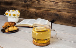 Bible and tea daisies croissants Stock Images