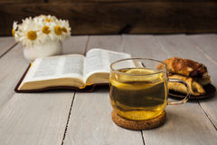 Bible and tea on wooden background Royalty Free Stock Photos
