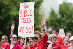 The Bible Tells Me So. An older participant protests and marches against hatred in the gay pride parade located in Des Moines, Iowa - 2015 stock photos