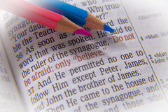 Bible text and crayons royalty free stock photography