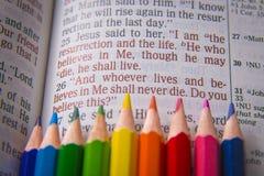 Bible text John 11:25 and crayons Royalty Free Stock Photos