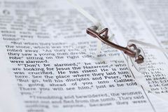 Bible with text in Mark 16:6 - He has risen Stock Photo