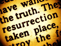 Bible text - Resurrection. A close up view of a Bible text from 1. epistle to Corithians chapter 15 with the focus on the words truth and resurrection. Sepia royalty free stock photos
