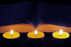Bible with three candles Royalty Free Stock Photo