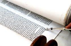 Bible torah. Holy Torah reading with silver finger at a bar mitzvah royalty free stock images