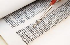 Bible torah. Torah reading with silver finger stock photo