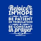 Bible typographique Réjouissez-vous dans l'espoir, soyez patient dans la tribulation, soyez constant dans la prière illustration libre de droits