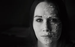 Bible verses on woman`s face Royalty Free Stock Image