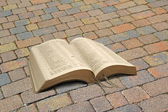 Bible on vintage cobbled path Royalty Free Stock Photos