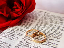 Bible and wedding rings. Closeup of Bible & wedding rings Stock Photo