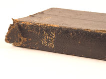 Bible on White 1. Tattered, old, black leather Holy Bible on white background Royalty Free Stock Photos