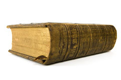 Bible on White Background. Antique bible resting on white background Stock Images