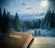 Bible with winter mountain scenics Stock Photos