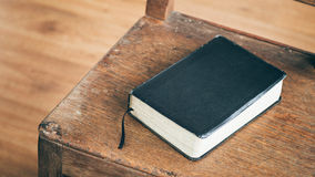 Bible on a Wooden Chair Royalty Free Stock Image