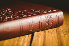 Bible on wooden table Stock Images