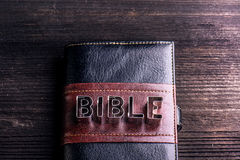 Bible on wooden table, sign made of cookie cutters royalty free stock photography