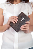 Bible. A young girl holding a bible in her hands stock photography