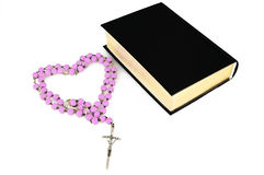 Bibles. And rosaries on white Stock Image