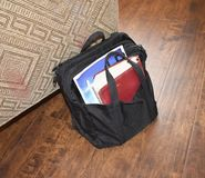 Bibles in black satchel that carries religious literature. Black satchel that carries bibles and religious literature along with pens and pencils stock photo